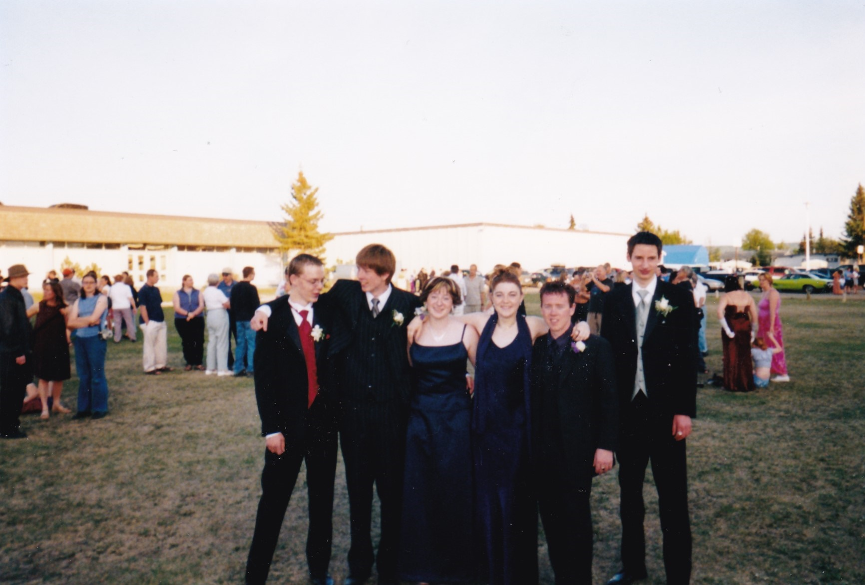 Graduation photographer a distant shot of me and my group of friends at the highschool before the grad banquet
